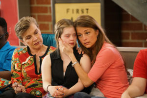 Cast member Megan cries while her mother, Kris, embraces her