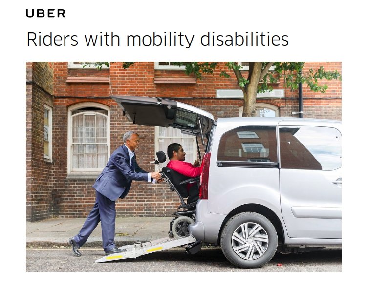 screeshot from uber accessibility site showing an image of an Uber driver assisting a rider in a wheelchair into an accessible vehicle